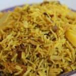 אורז בסמטי צהוב בתוספת תפוחי אדמה ושמיר